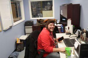 CSR event producer sitting at desk