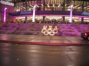 Olympic logo projected on outdoor stairs